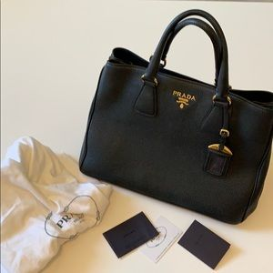 Galleria Bag Black Pebbled with Gold Hardware.